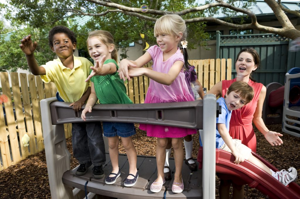 Children playing on a backyard home playground