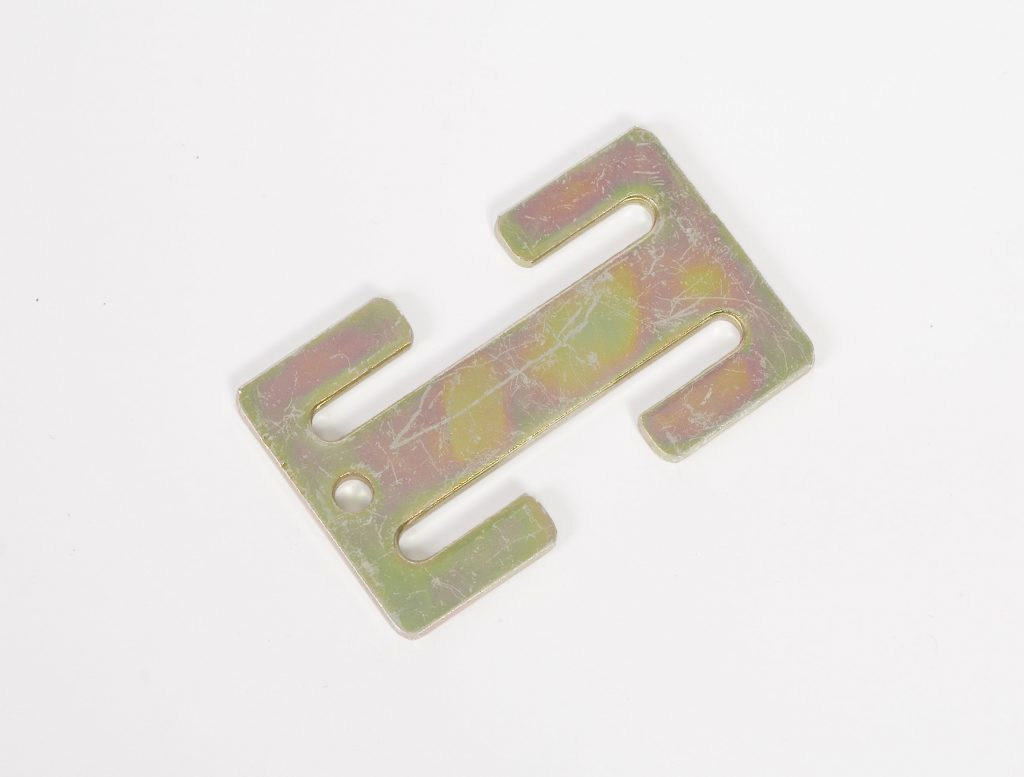 """Close-up of a metal """"H-shaped"""" bar known as the locking clip"""